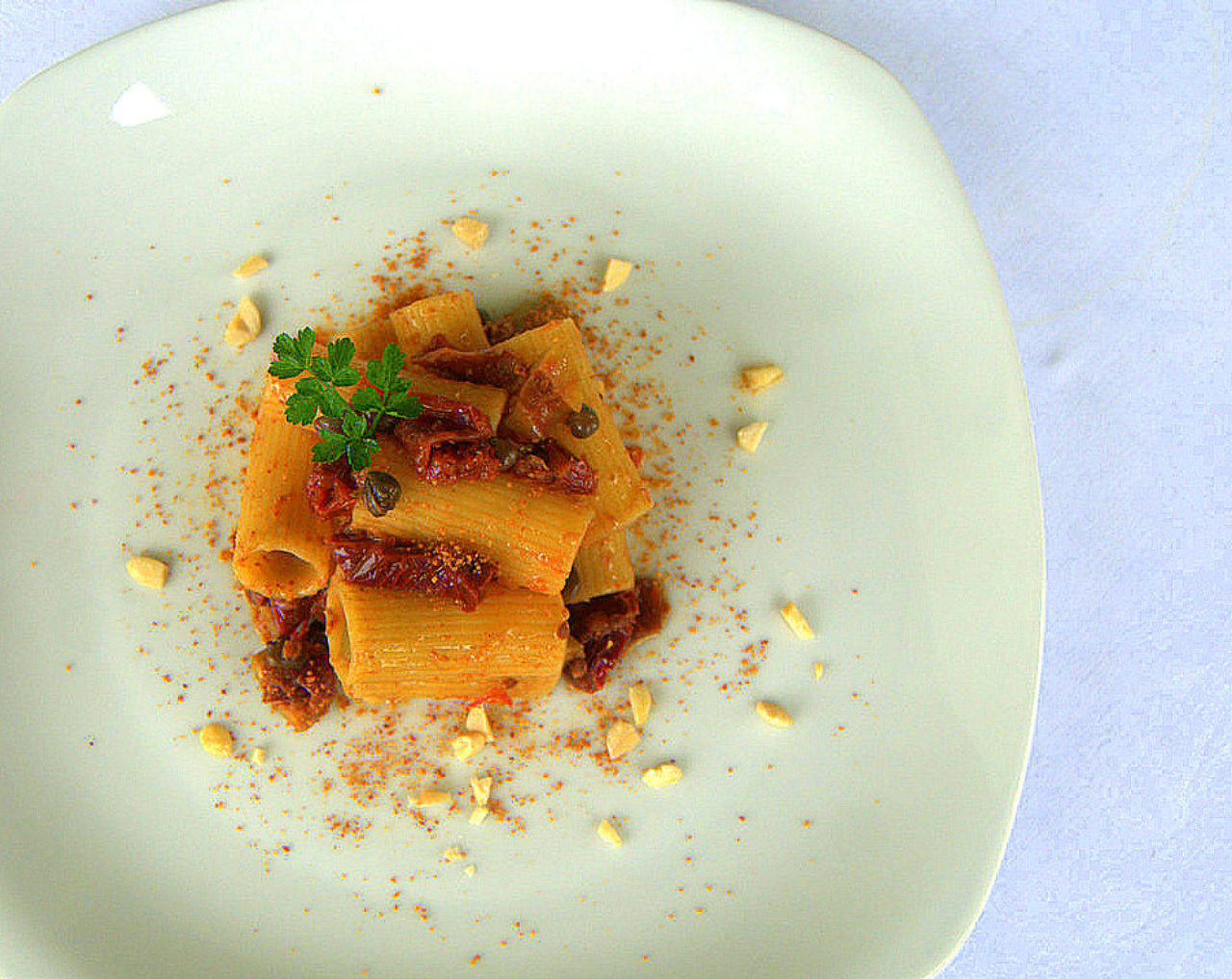 Rigatoni with sun-dried tomatoes, capers, olives and almonds