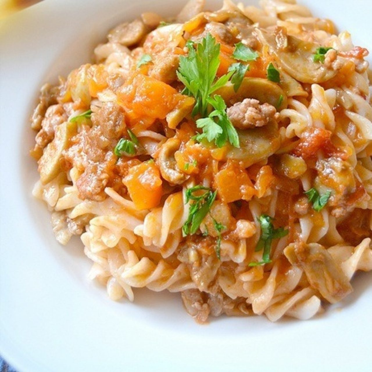 Fusilli with pumpkin, sausage and mushrooms sauce