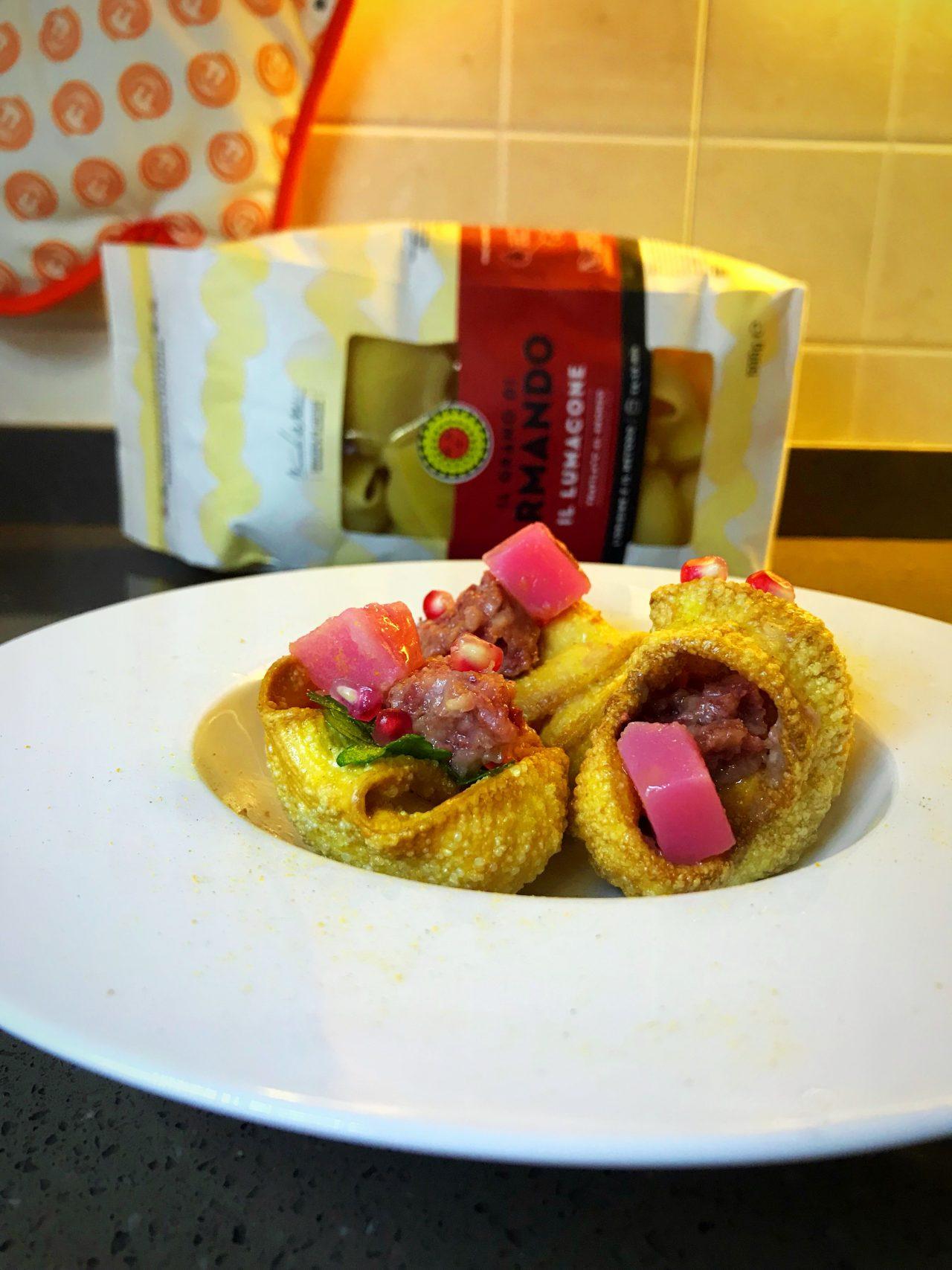Lumaconi pasta Armando con cotechino e gelatina di melograno