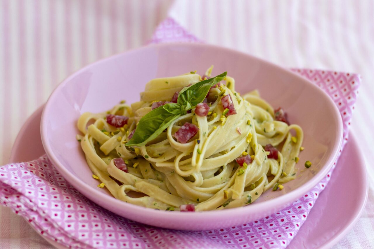 Linguine with creamed fava beans, basil, salami and pistachio