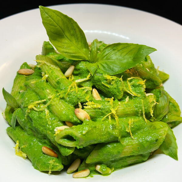 Pennette with cream of baby spinach, ricotta cheese, lemon and toasted pine nuts
