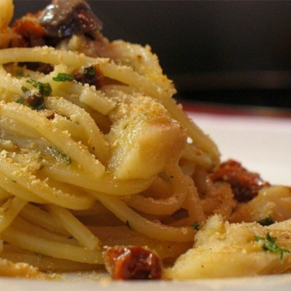 Spaghetti with cod fish, olives, capers and tomatoes